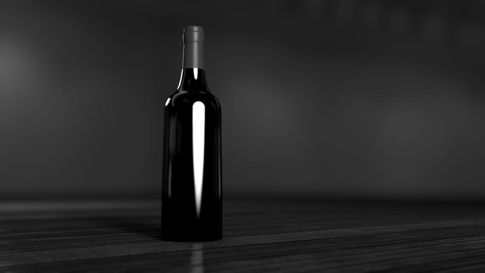 black glass bottle on brown surface