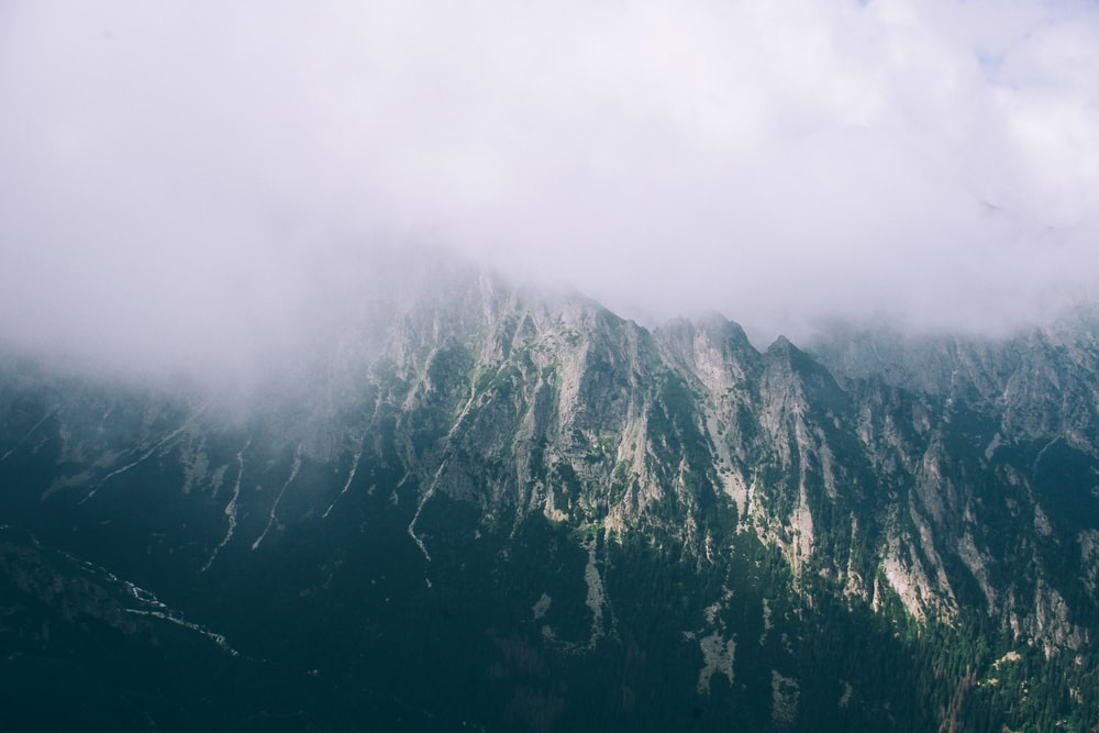 gray mountain covered with clouds