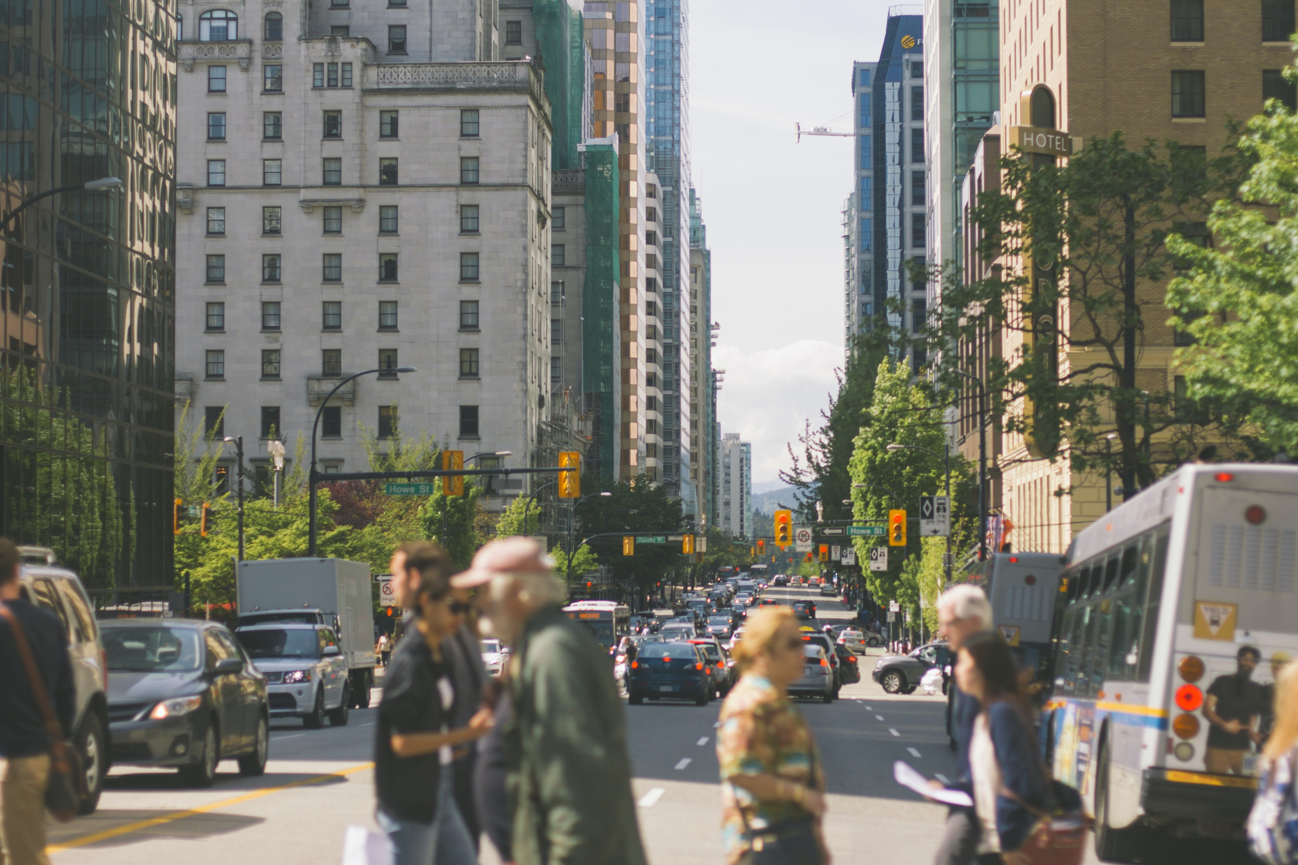 People on a crosswalk in a city on a bright day