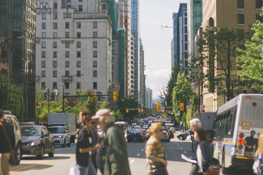 people crossing gray road