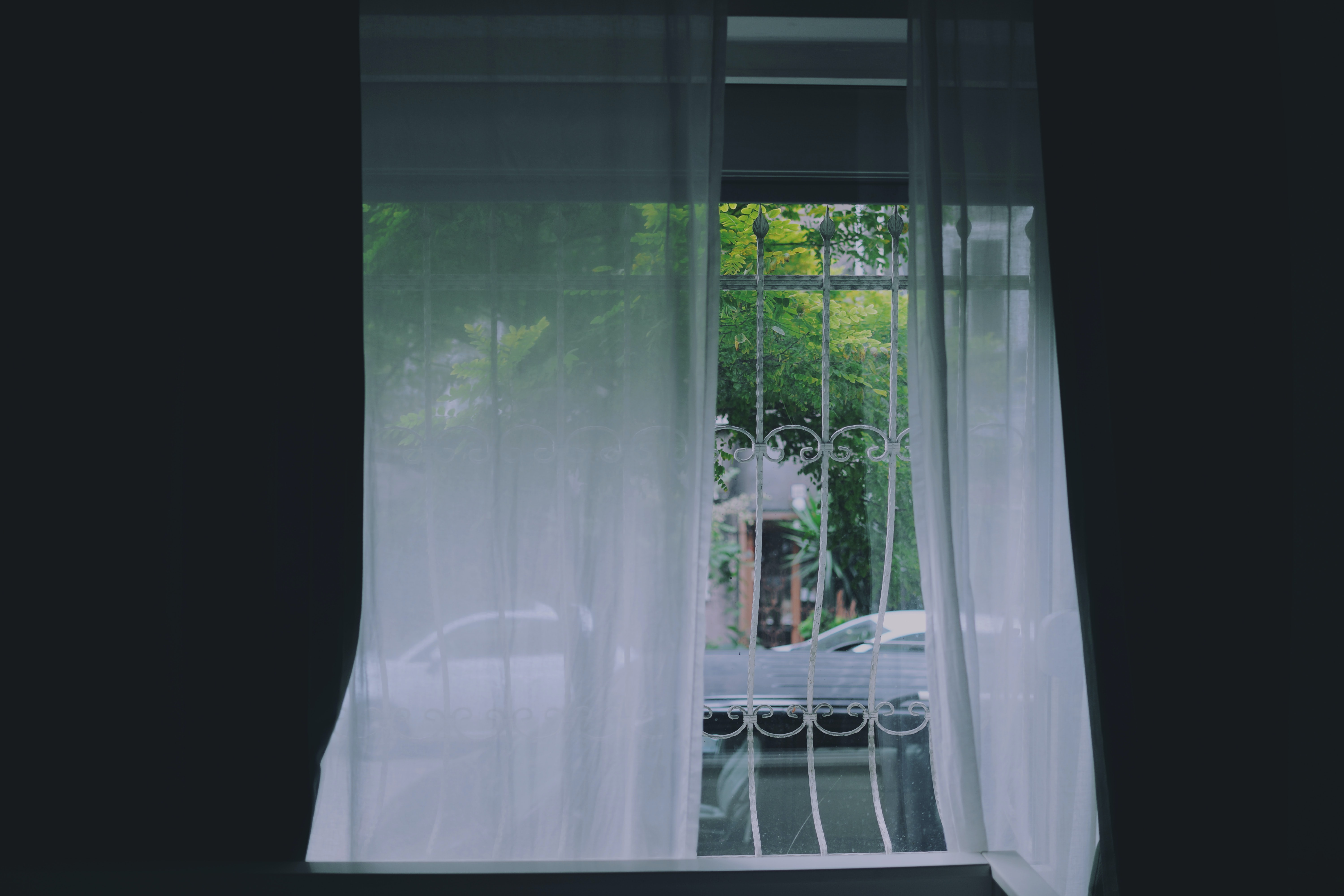 white curtain on white metal window
