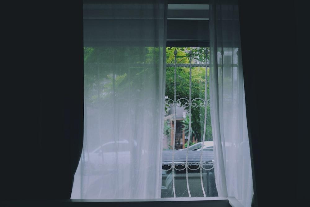 white curtain on white metal window