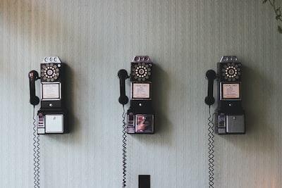 minimalist photography of three crank phones