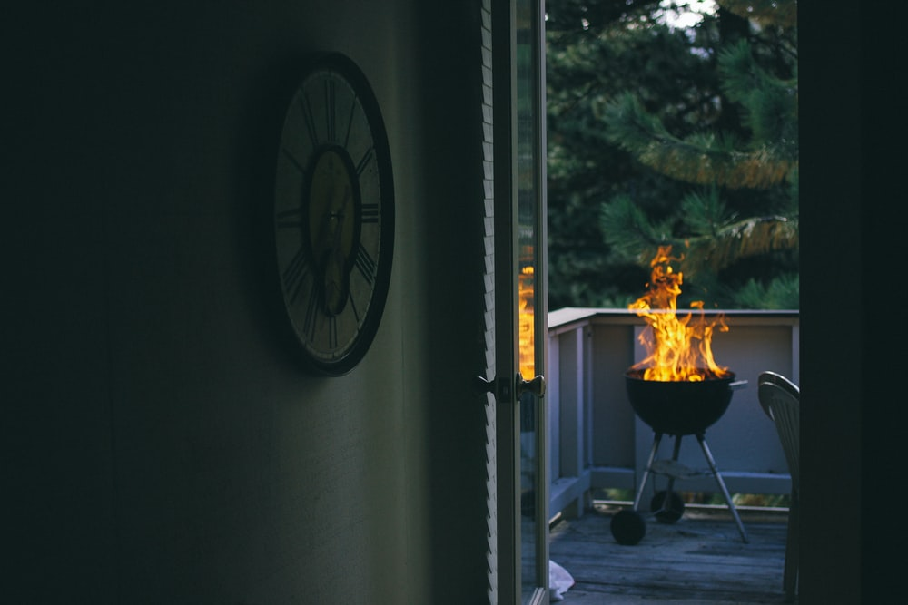 black charcoal grill on porch