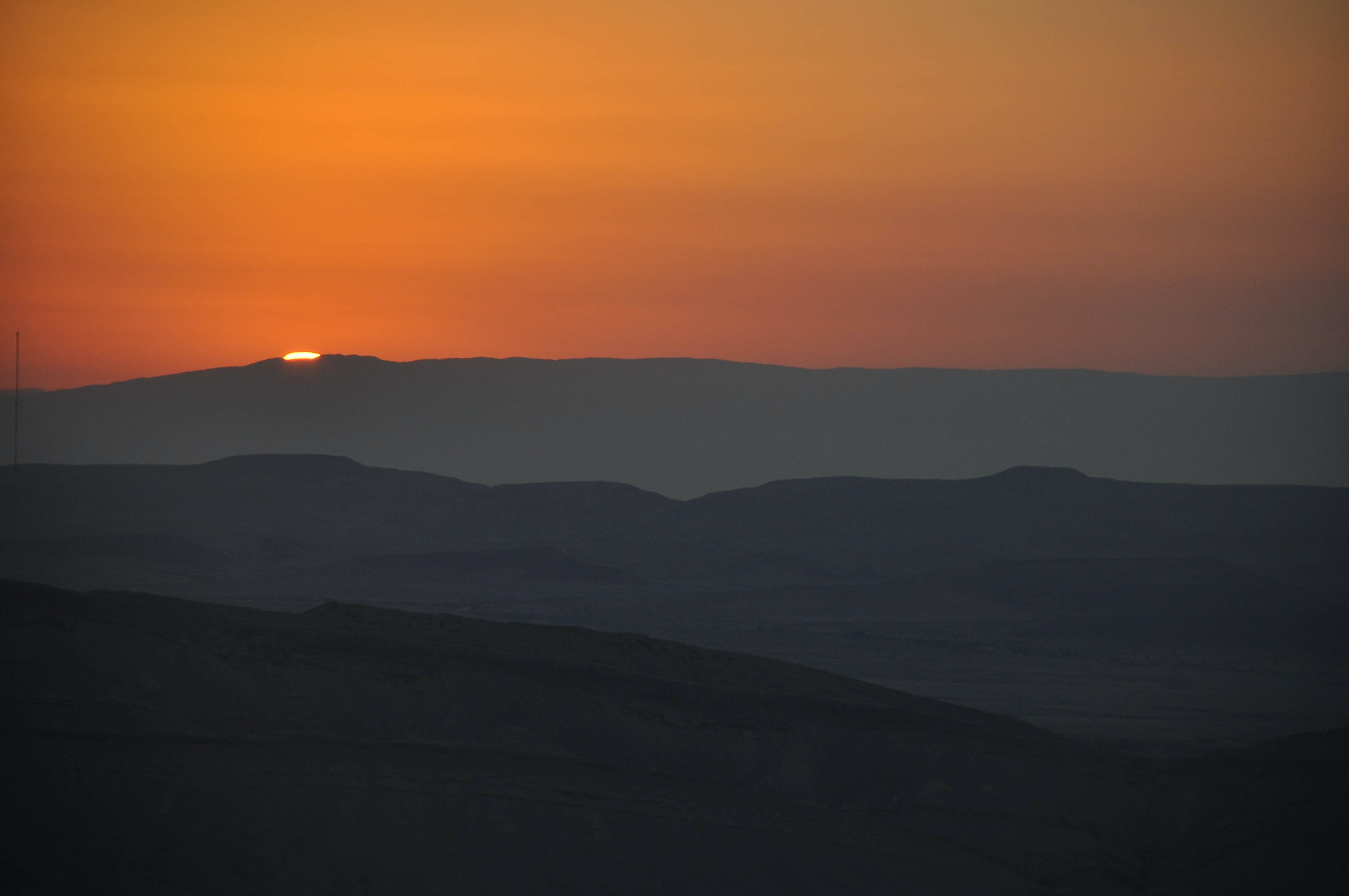 silhouette photography of mountain during senset